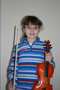 Emma with her violin...
